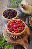 Rosehip berries, fresh and dried. Rustic style Stock Photo