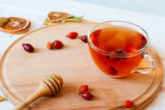 Rosehip drink with fresh berries in a glass cup Stock Photo