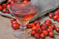 Rosehip fruit and liquor in a glass Royalty Free Stock Photography