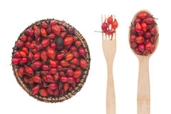 Rosehip in a plate, fork and spoon Royalty Free Stock Photography