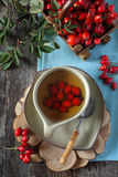 Rosehip tea and berries. In basket, top view Royalty Free Stock Photo