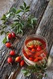 Rosehip tea and berries. Rosehip tea in glass cup and berries Stock Image