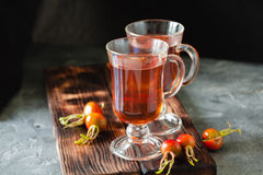 Rosehip tea in glass on black stone background Royalty Free Stock Image