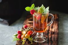 Rosehip tea in glass on black stone background Royalty Free Stock Photography