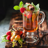 Rosehip tea in glass on black stone background Royalty Free Stock Photos