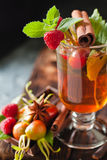 Rosehip tea in glass on black stone background Stock Photography
