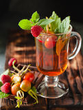 Rosehip tea in glass on black stone background Royalty Free Stock Images