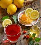 Rosehip tea with lemon. And honey Stock Photos