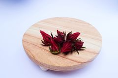 Rosella on Cutting Board. Rosella or hibiscus or kharkade or malvaceae or sorrel Seeds on Wood Round Cutting Board on White Background royalty free stock photos