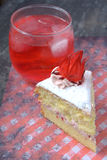 Rosella or Roselle Cake. Sponge Cake with roselle or rosella jam in the middle and roselle fruit on top of rosella cream flavour Royalty Free Stock Photo