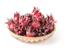 Roselle fruit in bamboo basket isolated. On wite Stock Photo