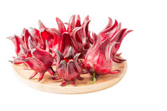 Roselle fruit isolated on wood plate Stock Image