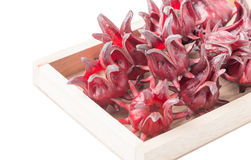 Roselle fruit in wood box isolated Royalty Free Stock Photos