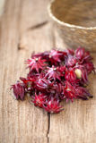 Roselle Hibiscus sabdariffa red fruit flower on wooden background. used for making tea or syrup. selective focus. Roselle Hibiscus sabdariffa red fruit flower royalty free stock photo