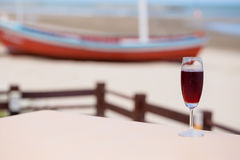 Roselle juice with beach view. Glass of roselle juice with beach view stock images