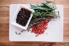 Rosemary with black and pink pepper corns Royalty Free Stock Image
