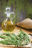 Rosemary and Bottle of Olive Oil Stock Images