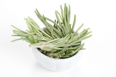 Rosemary in a bowl on white background. Royalty Free Stock Photos