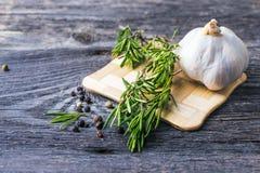 Rosemary branch and garlic Stock Image