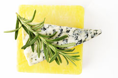 Rosemary on cheese Royalty Free Stock Image