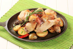 Rosemary chicken drumsticks and potatoes Royalty Free Stock Images