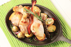 Rosemary chicken drumsticks and potatoes Stock Images