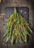 Rosemary Christmas tree with red chili decoration Stock Photo