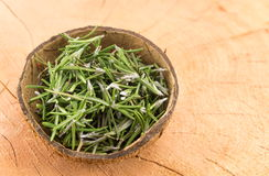 Rosemary in a coconut shell Royalty Free Stock Image