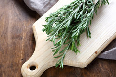 Rosemary on a cutting board Stock Photos