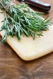Rosemary on a cutting board Stock Photo