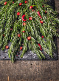 Rosemary and cutting red chili with spices and salt on slate Royalty Free Stock Photos