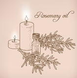 Rosemary essential oil and candles Stock Photo
