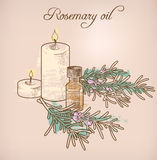 Rosemary essential oil and candles Royalty Free Stock Photos