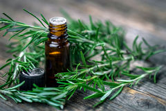 Rosemary essential oil and fresh rosemary Stock Photos
