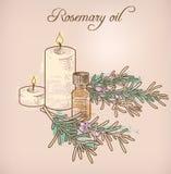 Rosemary etherische olie en kaarsen Royalty-vrije Stock Foto's