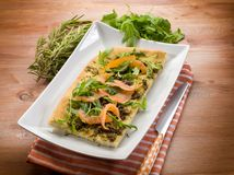 Rosemary focaccia with smoked salmon. Arugula and rosemary royalty free stock images