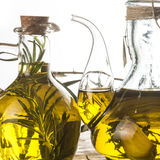 Rosemary and garlic infused olive oil Stock Photos