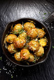 Rosemary and garlic roast potatoes on a cast iron pan Royalty Free Stock Image
