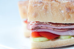 Rosemary ham sandwich on baguette with fresh tomato and cucumber Royalty Free Stock Photos