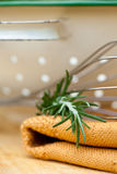 Rosemary herbs and cooking utensils Royalty Free Stock Photos