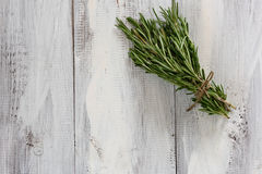 Rosemary herbs. On a wooden table Stock Photos