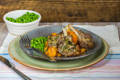Rosemary lamb chops with carrot and parsnip mash and green peas Stock Photography