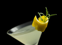 Rosemary Lemontini cocktail isolated on black Stock Photo