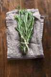 Rosemary on a napkin Stock Images