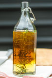 Rosemary Oil in The Glass Bottle on Folded Napkin with Fresh Rosemary inside.  Royalty Free Stock Photo
