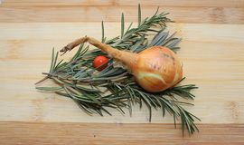 Rosemary,onion, red berry and lavender on a wooden board stock photography