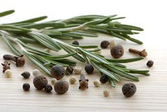 Rosemary, peppercorn and cloves Stock Photos
