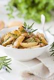 Rosemary potato wedges. Fresh roasted rosemary potato wedges Royalty Free Stock Image