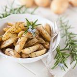 Rosemary potato wedges. Fresh roasted rosemary potatoes wedges Stock Photo