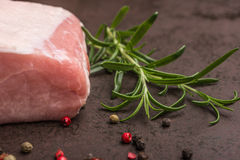 Rosemary and raw iberico pork meat Royalty Free Stock Photography